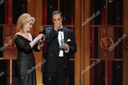 """Kinky Boots"""" producers Daryl Roth, left, and Hal Luftig, right, accept the award for Best Musical, at the 67th Annual Tony Awards, on in New York"""