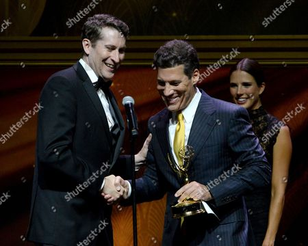 Stock Photo of Scott Aukerman, left, and Christopher Wolfe speak at the 67th Los Angeles Area Emmy Awards at the Skirball Cultural Center on