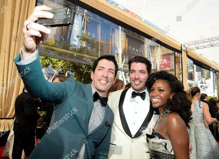 Drew Scott, and from left, Jonathan Silver Scott, and Teyonah Parris arrive at the 67th Primetime Emmy Awards, at the Microsoft Theater in Los Angeles