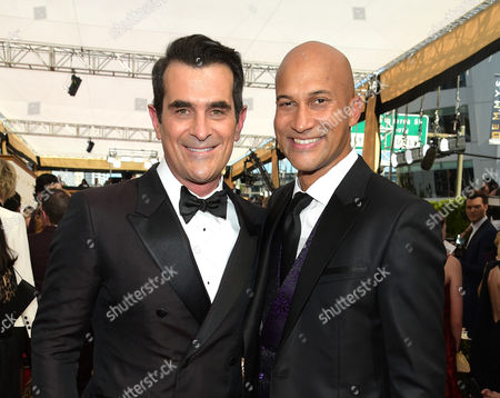 Stock Picture of Ty Burrell, left, and Keegan-Michael Key arrive at the 67th Primetime Emmy Awards, at the Microsoft Theater in Los Angeles
