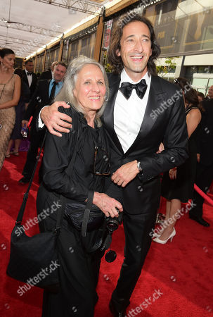 Sylvia Plachy, left, and Adrien Brody arrive at the 67th Primetime Emmy Awards, at the Microsoft Theater in Los Angeles