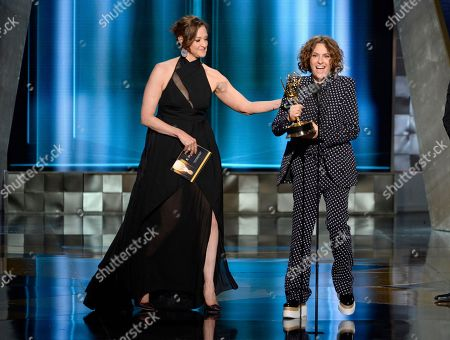 Jill Soloway accepts the award for outstanding directing for a comedy series for Transparent at the 67th Primetime Emmy Awards, at the Microsoft Theater in Los Angeles. Pictured at left is Joan Cusack