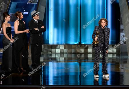 Jill Soloway accepts the award for outstanding directing for a comedy series for Transparent at the 67th Primetime Emmy Awards, at the Microsoft Theater in Los Angeles. Pictured from second left are Joan Cusack and Bradley Whitford