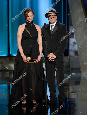 Joan Cusack, left, and Bradley Whitford present the award for outstanding directing for a comedy series at the 67th Primetime Emmy Awards, at the Microsoft Theater in Los Angeles