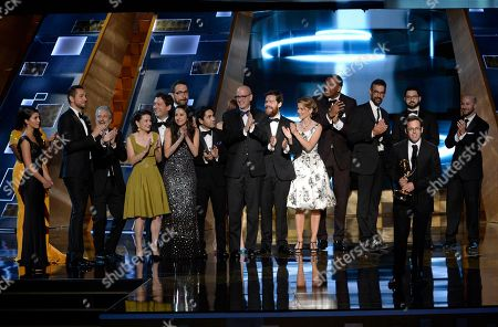 Stock Picture of Elliott Kalan, second from right, and the cast and crew of The Daily Show With Jon Stewart accept the award for outstanding writing for a variety series at the 67th Primetime Emmy Awards, at the Microsoft Theater in Los Angeles