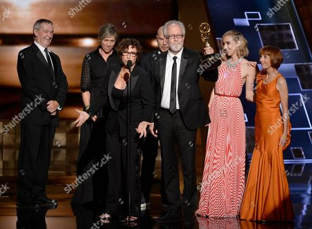 "Lisa Cholodenko, third from left, and the cast and crew of ""Olive Kitteridge"" accepts the award for outstanding limited series for Olive Kitteridge at the 67th Primetime Emmy Awards, at the Microsoft Theater in Los Angeles"