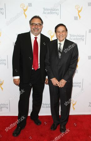 Don Hahn, left, and Richard Sherman arrive at the L.A. Area Emmy Awards presented at the Television Academy's new Saban Media Center, in the NoHo Arts District in Los Angeles