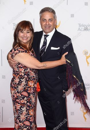 Robbi Morgan, left, and Mark L. Walberg arrive at the L.A. Area Emmy Awards presented at the Television Academy's new Saban Media Center, in the NoHo Arts District in Los Angeles