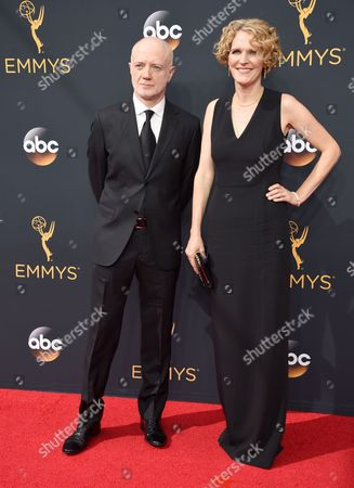 Frank Pugliese, left, and Melissa James Gibson arrive at the 68th Primetime Emmy Awards, at the Microsoft Theater in Los Angeles