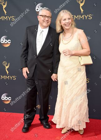 Jeffrey Toobin, left, and Amy Bennett McIntosh arrive at the 68th Primetime Emmy Awards, at the Microsoft Theater in Los Angeles