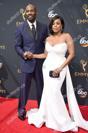 Jay Tucker, left, and Niecy Nash arrives at the 68th Primetime Emmy Awards, at the Microsoft Theater in Los Angeles