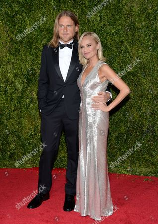 Stock Photo of Andrew Pruett, left, and Kristin Chenoweth arrive at the 69th annual Tony Awards at Radio City Music Hall, in New York