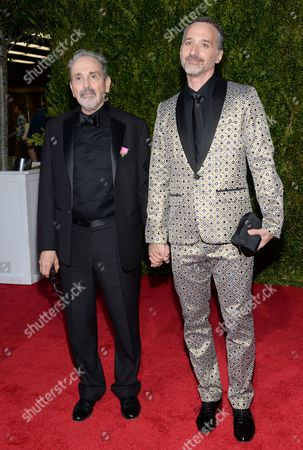 Craig Lucas, left, and Frankie Krainz arrive at the 69th annual Tony Awards at Radio City Music Hall, in New York