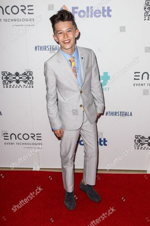 Stock Photo of Nolan Gross attends the 6th Annual Thirst Gala at The Beverly Hilton Hotel on in Beverly Hills, Calif