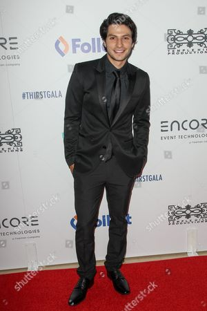 Stock Image of George Kosturos attends the 6th Annual Thirst Gala at The Beverly Hilton Hotel on in Beverly Hills, Calif