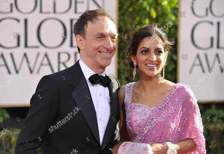 Mychael Danna, left, and Aparna Danna arrive at the 70th Annual Golden Globe Awards at the Beverly Hilton Hotel, in Beverly Hills, Calif
