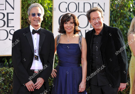 Dick Clark Productions (DCP) CEO Allen Shapiro, DCP President Orly Adelson, and DCP Executive Vice President Barry Adelman arrive at the 70th Annual Golden Globe Awards at the Beverly Hilton Hotel, in Beverly Hills, Calif