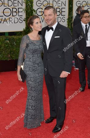 Stock Photo of Caroline Fentress, left, and Chris O'Donnell arrive at the 71st annual Golden Globe Awards at the Beverly Hilton Hotel, in Beverly Hills, Calif