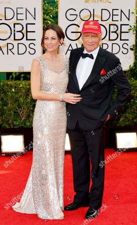 Birgit Wetzinger, left, and Niki Lauda arrive at the 71st annual Golden Globe Awards at the Beverly Hilton Hotel, in Beverly Hills, Calif