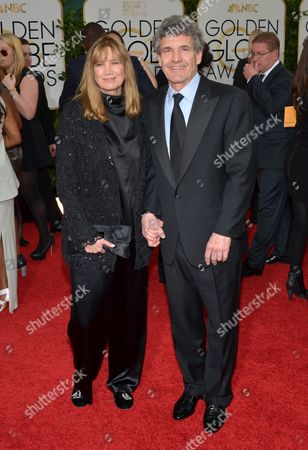 Alan Horn, Chairman, The Walt Disney Studios, right, and Cindy Horn arrive at the 71st annual Golden Globe Awards at the Beverly Hilton Hotel, in Beverly Hills, Calif