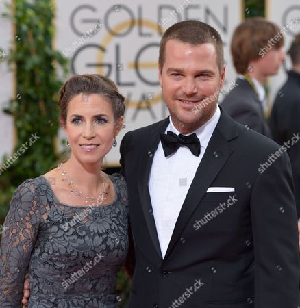 Caroline Fentress, left, and Chris O'Donnell arrive at the 71st annual Golden Globe Awards at the Beverly Hilton Hotel, in Beverly Hills, Calif