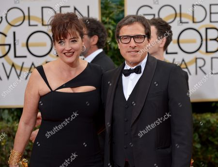 David O. Russell, right, and Janet Grillo arrive at the 71st annual Golden Globe Awards at the Beverly Hilton Hotel, in Beverly Hills, Calif