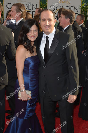 "Richard Suckle, producer of ""American Hustle,"" and his wife Maia arrive at the 71st annual Golden Globe Awards at the Beverly Hilton Hotel, in Beverly Hills, Calif"