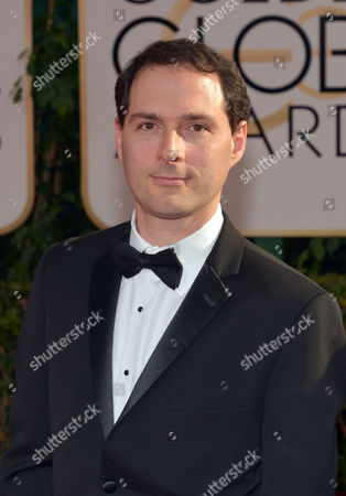 Alex Heffes arrives at the 71st annual Golden Globe Awards at the Beverly Hilton Hotel, in Beverly Hills, Calif