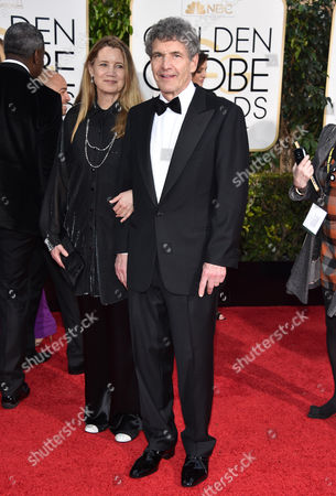 Cindy Horn, left, and Alan F. Horn, Chairman of The Walt Disney Studios, arrive at the 72nd annual Golden Globe Awards at the Beverly Hilton Hotel, in Beverly Hills, Calif