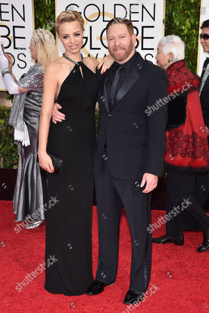 Jessica Roffey, left, and Relativity Media CEO Ryan Kavanaugh arrive at the 72nd annual Golden Globe Awards at the Beverly Hilton Hotel, in Beverly Hills, Calif