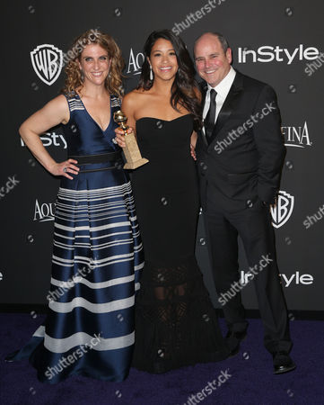 Jennie Snyder, from left, Gina Rodriguez, and David Stapf arrives at the 16th annual InStyle and Warner Bros. Golden Globes afterparty at the Beverly Hilton Hotel, in Beverly Hills, Calif