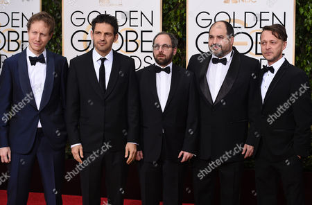 Laszlo Nemes, from left, Geza Rohrig, Gabor Sipos, Gabor Rajna, and Levente Molnar arrive at the 73rd annual Golden Globe Awards, at the Beverly Hilton Hotel in Beverly Hills, Calif