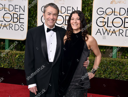 Carter Burwell, left, and Christine Sciulli arrive at the 73rd annual Golden Globe Awards, at the Beverly Hilton Hotel in Beverly Hills, Calif