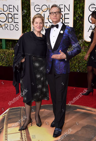 Laurie Karon, left, and Paul Feig arrive at the 73rd annual Golden Globe Awards, at the Beverly Hilton Hotel in Beverly Hills, Calif