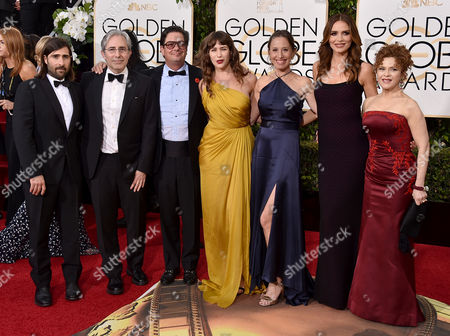 Jason Schwartzman, from left, Paul Weitz, Roman Coppola, Lola Kirke, Caroline Baron, Saffron Burrows, and Bernadette Peters arrive at the 73rd annual Golden Globe Awards, at the Beverly Hilton Hotel in Beverly Hills, Calif