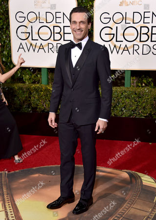 John Hamm arrives at the 73rd annual Golden Globe Awards, at the Beverly Hilton Hotel in Beverly Hills, Calif