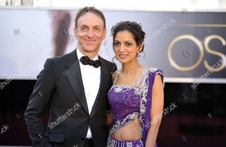 Composer Mychael Danna, left, and Aparna Danna arrives at the 85th Academy Awards at the Dolby Theatre, in Los Angeles