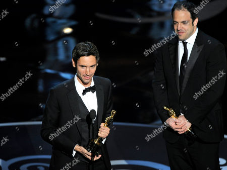 """Malik Bendjelloul, left, and Simon Chinn accept the award for best documentary feature for """"Searching for Sugar Man"""" during the Oscars at the Dolby Theatre, in Los Angeles"""