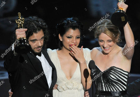 "Sean Fine, from left, Inocente Izucar and Andrea Nix Fine accept the award for best documentary short for ""Inocente"" during the Oscars at the Dolby Theatre, in Los Angeles"