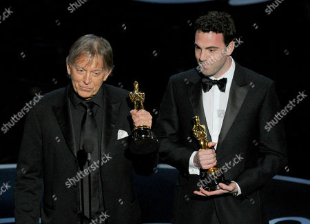 """Andy Nelson, left, and Mark Paterson accept the award for best sound mixing for """"Les Miserables"""" during the Oscars at the Dolby Theatre, in Los Angeles"""