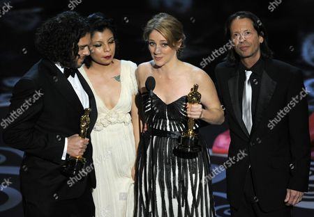 "From left, Sean Fine, Inocente Izucar and Andrea Nix Fine accept the award for best documentary short for ""Inocente"" during the Oscars at the Dolby Theatre, in Los Angeles"
