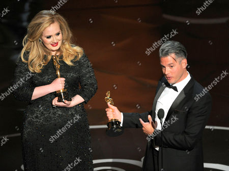 "Singer Adele, left, and musician/producer Paul Epworth accept the award for best original song for ""Skyfall"" from ""Skyfall"" during the Oscars at the Dolby Theatre, in Los Angeles"