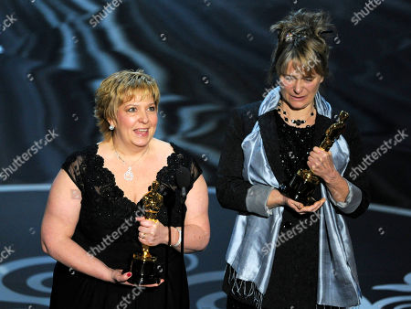"Lisa Westcott, left, and Julie Dartnell accept the award for best makeup and hairstyling for ""Les Miserables"" during the Oscars at the Dolby Theatre, in Los Angeles"