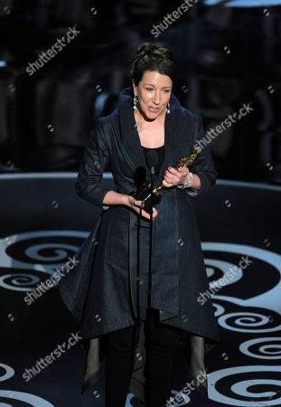 """Jacqueline Durran accepts the award for best costume design for """"Anna Karenina"""" during the Oscars at the Dolby Theatre, in Los Angeles"""