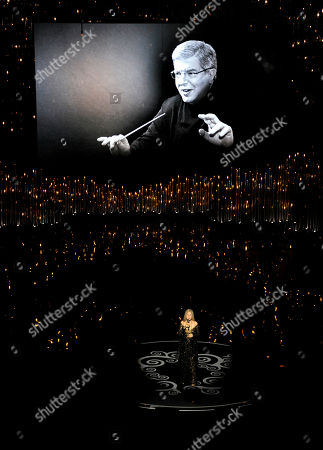 """Actress/singer Barbra Streisand performs """"The Way We Were"""" for the In Memoriam tribute during the Oscars at the Dolby Theatre, in Los Angeles. Pictured on the screen is the song's Oscar-winning composer, Marvin Hamlisch, who died in 2012"""
