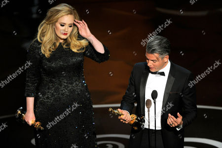 "Singer Adele, left, and musician/producer Paul Epworth accept the award for best music - original song for ""Skyfall"" from ""Skyfall"" during the Oscars at the Dolby Theatre, in Los Angeles"