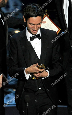 """Malik Bendjelloul accepts the award for best documentary feature for """"Searching for Sugar Man"""" during the Oscars at the Dolby Theatre, in Los Angeles"""