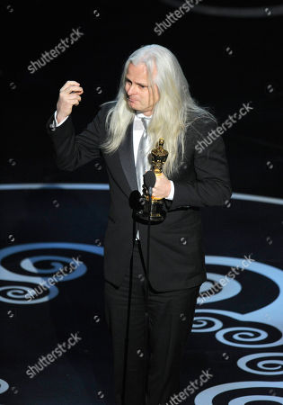 """Claudio Miranda accepts the award for best cinematography for """"Life of Pi"""" during the Oscars at the Dolby Theatre, in Los Angeles"""