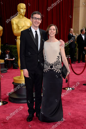 Steven Price, left, and guest arrive at the Oscars, at the Dolby Theatre in Los Angeles
