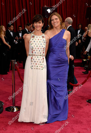Kristine Belson, left, and Jane Hartwell arrive at the Oscars, at the Dolby Theatre in Los Angeles
